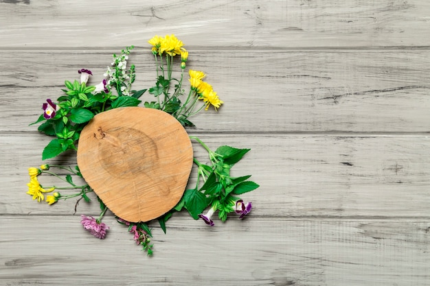 Wooden circle with bright flowers around