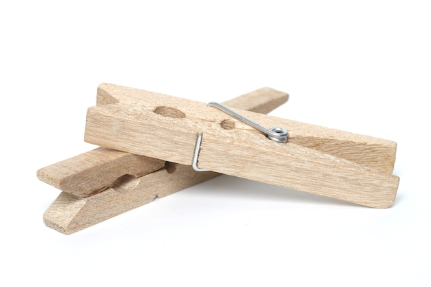 Wooden clothes peg isolated on a white background.