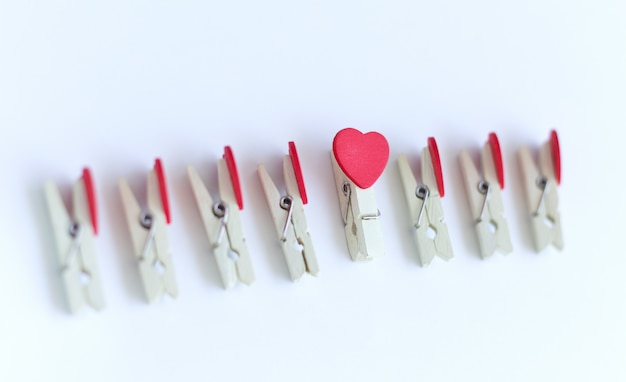 Wooden clothes pin or cloth pegs with heart
