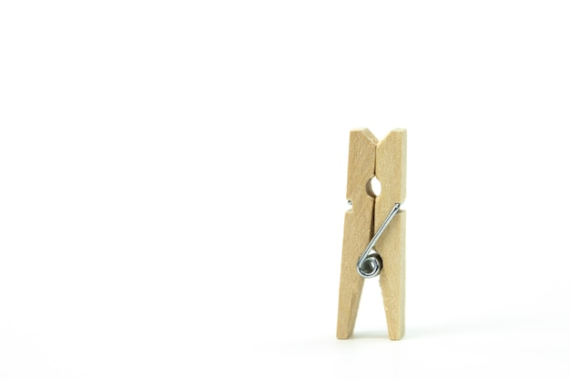 Wooden clothespin, standing alone on white surface. concept of loneliness