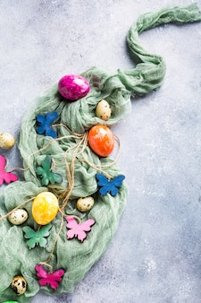 Wooden colored butterflies with easter eggs