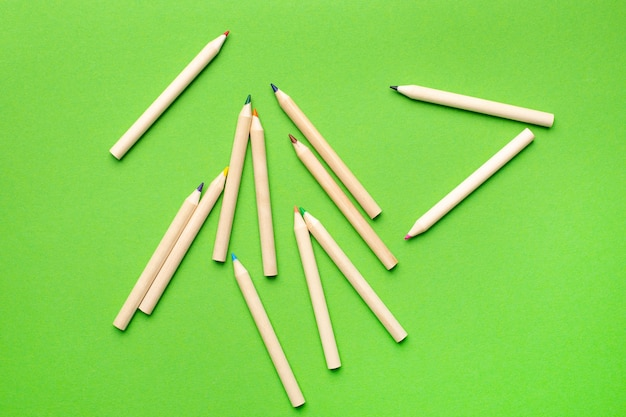 Wooden colored pencils and green