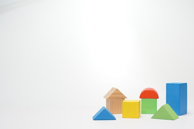 Wooden colored toy blocks on white.