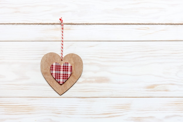 Wooden colorful heart on rope. valentine day, wedding, engagement and romantic events.