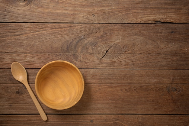 Wooden cookware on dark old wooden table texture background top view