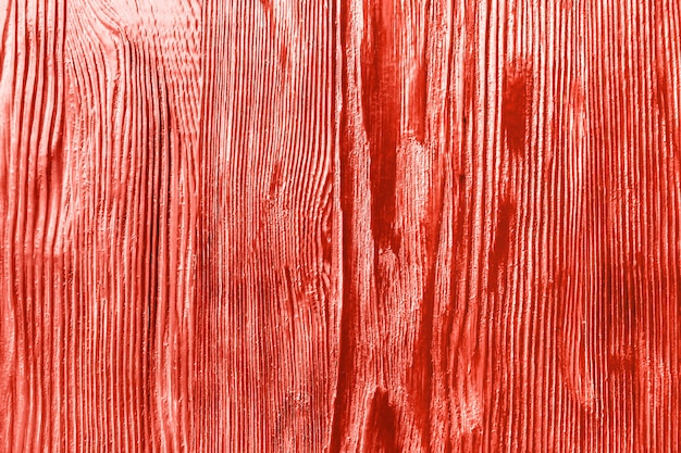 Wooden coral color rough textured background.