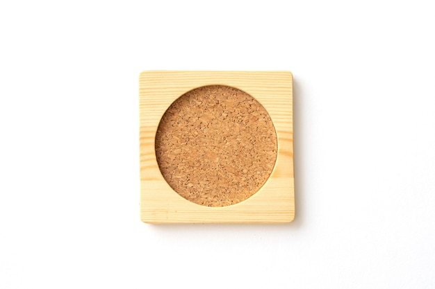 Wooden cork plate mat for water glass or coffee cup. close-up.