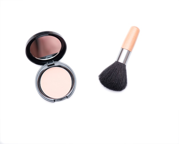 Wooden cosmetic brush and open box with face powder isolated