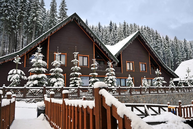 Wooden cottage holiday house in mountain holiday resort covered