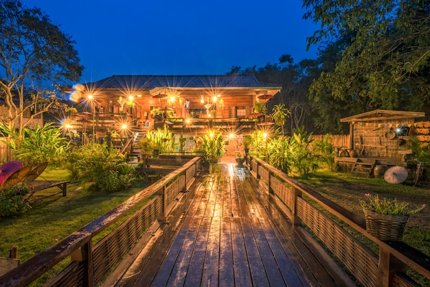Wooden cottage home stay at twilight in sukhothai, thailand.