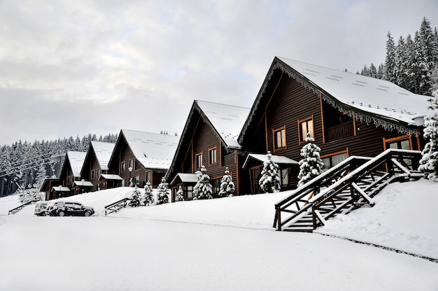 Wooden cottages holiday house in mountain holiday resort covered