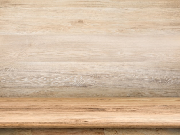グランジレンガの壁の背景を持つ木製のカウンタートップ