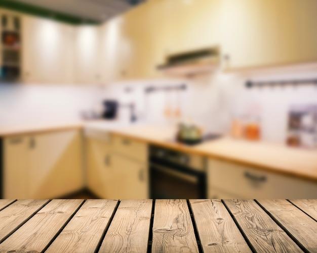 キッチンのぼやけた背景と木製のカウンタートップ