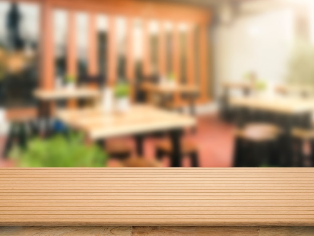 Wooden counter top with restaurant blurred background