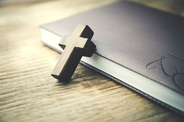 Wooden crosses on book
