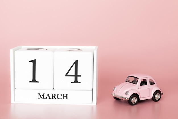 Wooden cube 14th of march. day 14 of march month, calendar on a pink background with retro car.