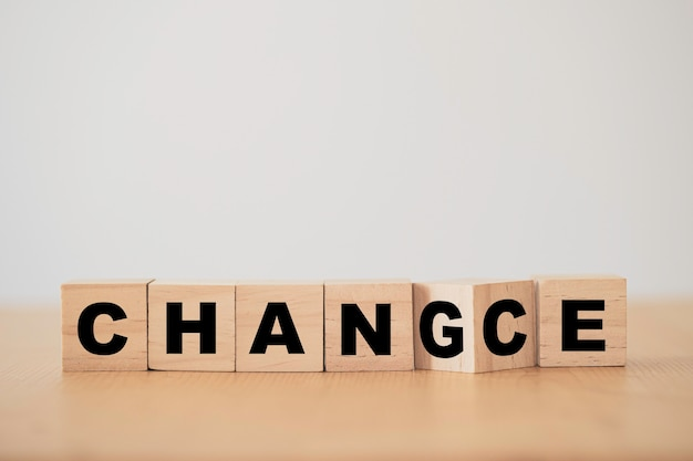 Wooden cube block flipping for change to chance wording.
