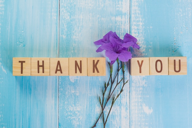 Wooden cube block thank you word with purple flower