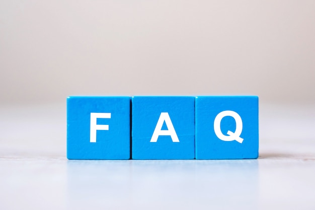 Wooden cube blocks with faq text ( frequently asked questions)