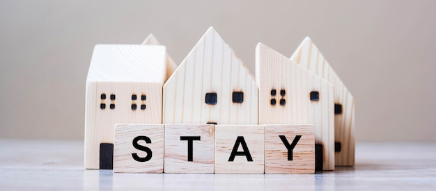 Wooden cube blocks with stay text and home model