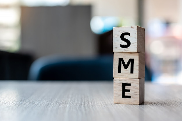 Wooden cube with sme text (small medium enterprise)