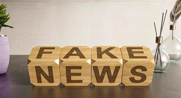 Деревянные кубики на столе с фейковыми новостями