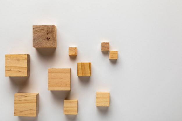 Wooden cubes on plain background