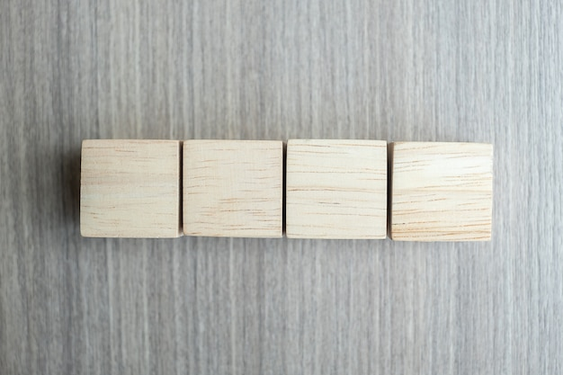 Wooden cubes on table background with copy space for text