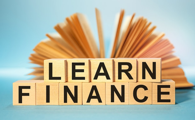 Wooden cubes with the abbreviation learn finance