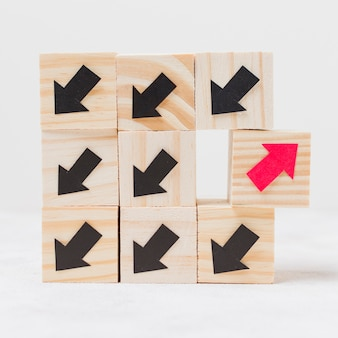 Wooden cubes with arrows originality concept