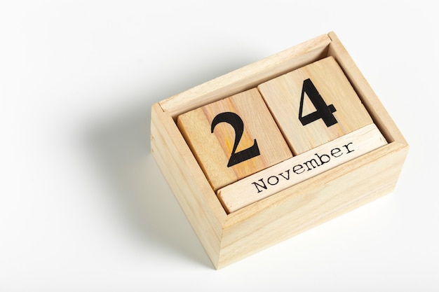 Wooden cubes with date on white background. 24th of november