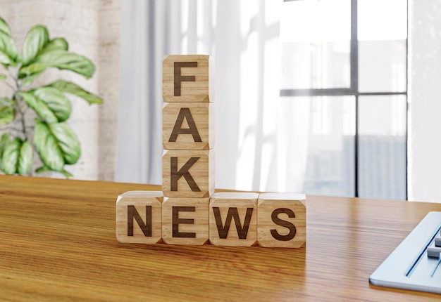 Wooden cubes with fake news on the table