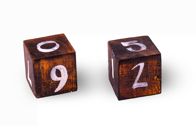 Wooden cubes with figures on white wall.