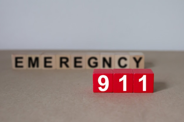 Wooden cubes with graphics 911 emergency number.
