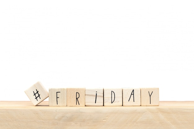Wooden cubes with a hashtag and the word friday, social media concept