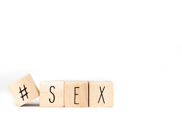 Wooden cubes with a hashtag and the word sex isolated, social media concept