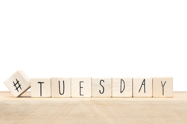 Wooden cubes with a hashtag and the word tuesday, social media concept