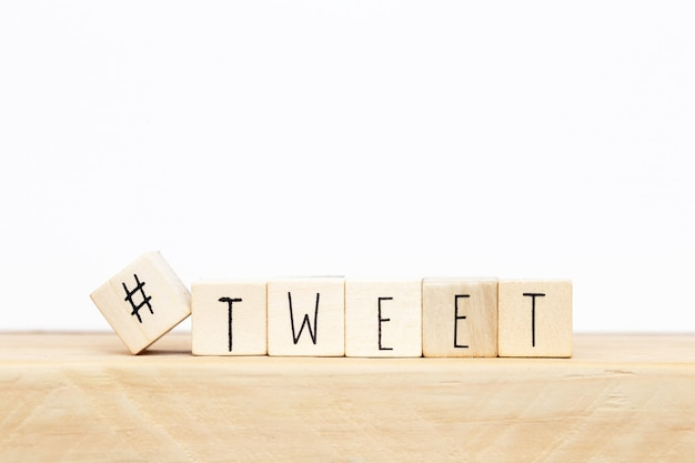 Wooden cubes with a hashtag and the word tweet, social media concept