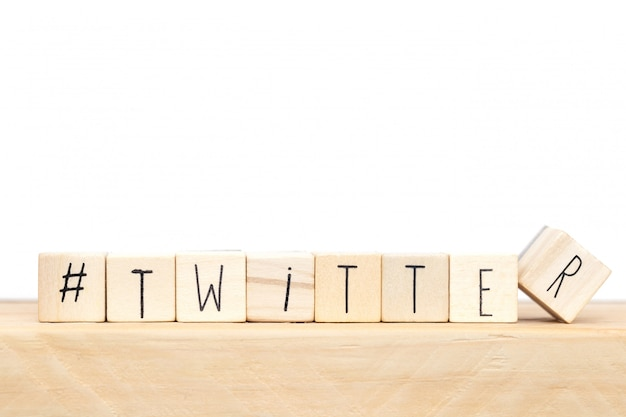 Wooden cubes with a hashtag and the word twitter, social media concept