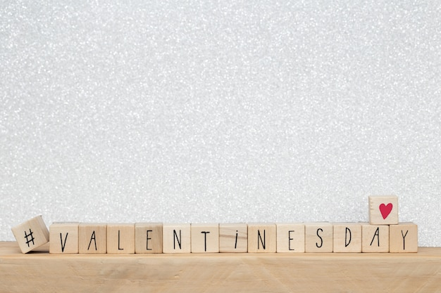Wooden cubes with hashtag and the word valentine's day, social media concept