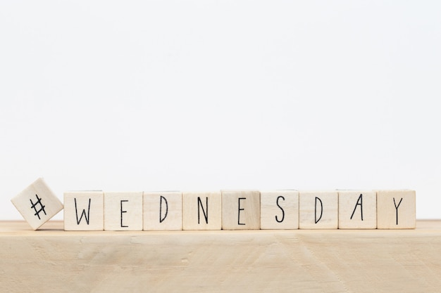 Wooden cubes with a hashtag and the word wednesday, social media concept