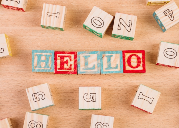 Wooden cubes with hello title on floor
