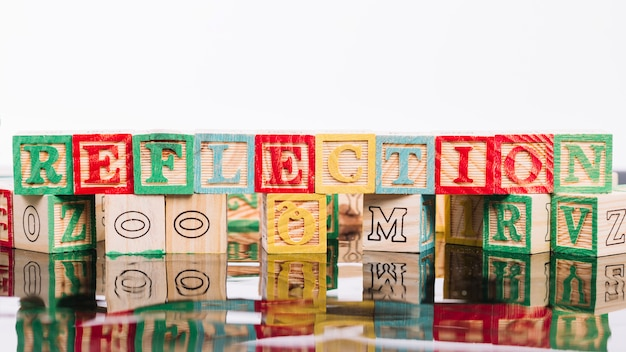 Wooden cubes with reflection title