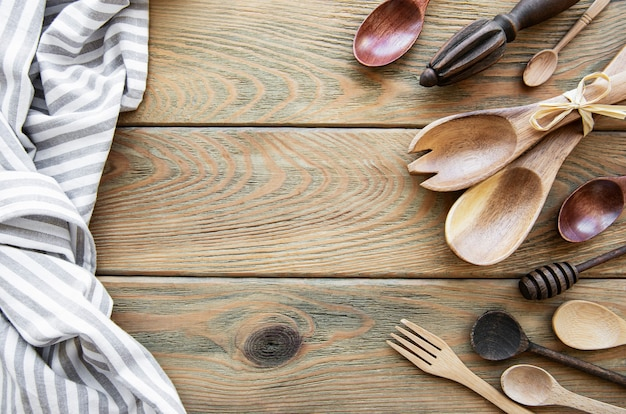 Wooden cutlery kitchen  ware on a  old wooden background