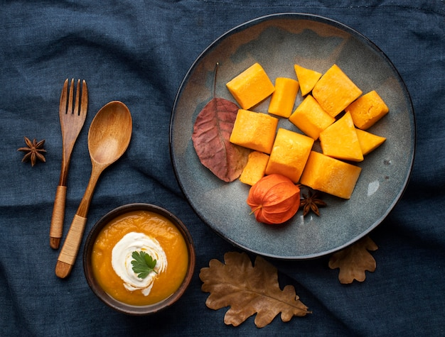 Wooden cutlery and pumpkin dish
