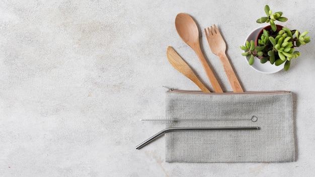 Wooden cutlery on wallet copy space