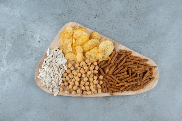 A wooden cutting board full of delicious snacks. high quality photo