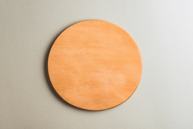Wooden cutting board on gray backdrop