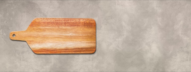 Wooden cutting board isolated on concrete background. horizontal panoramic banner
