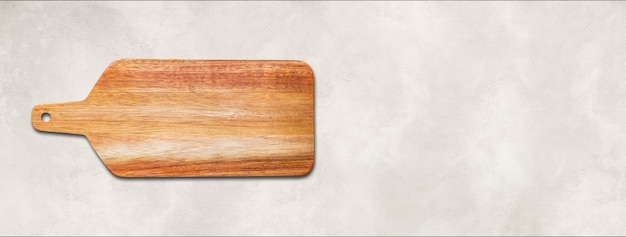 Wooden cutting board isolated on white concrete background. horizontal panoramic banner